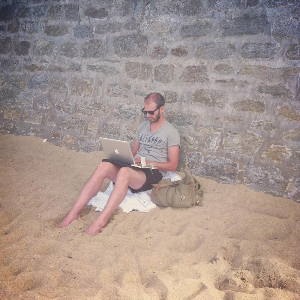 Kino working on the beach