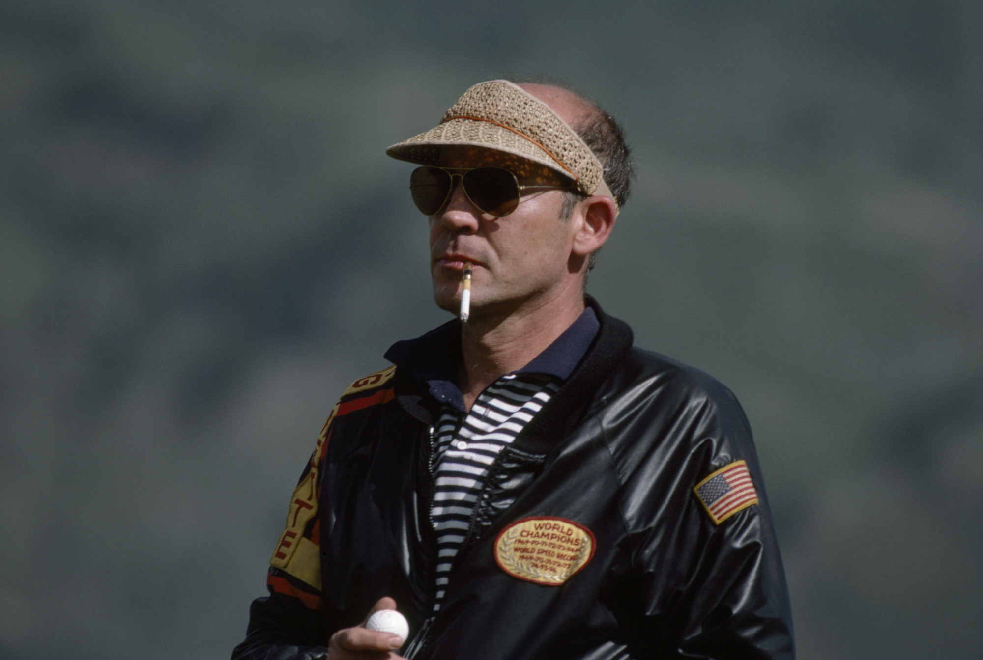Legendary journalist and writer Hunter Thompson plays golf