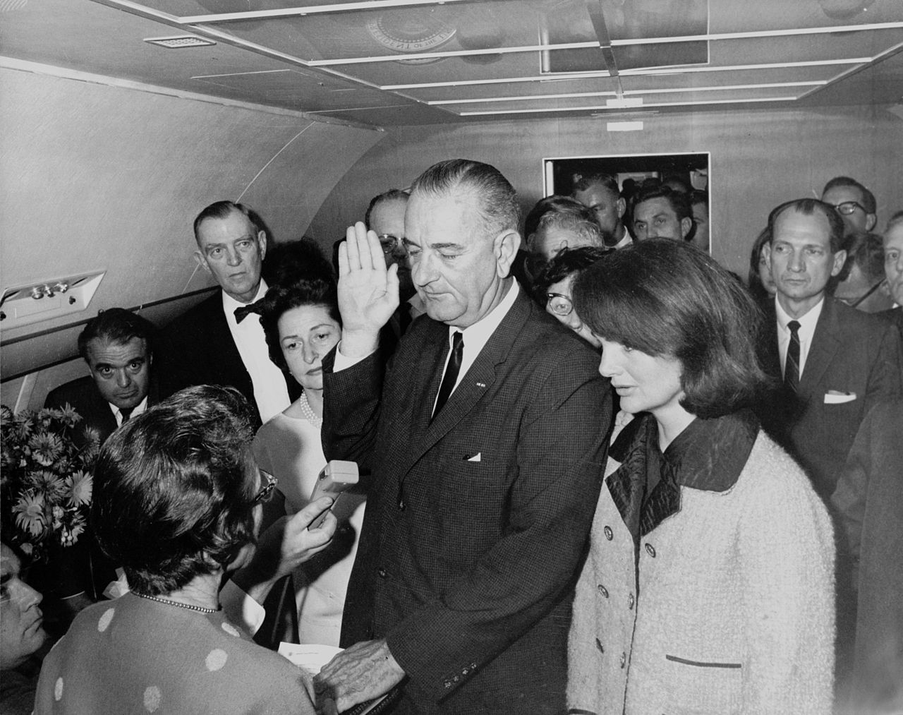 1280px-Lyndon_B._Johnson_taking_the_oath_of_office,_November_1963