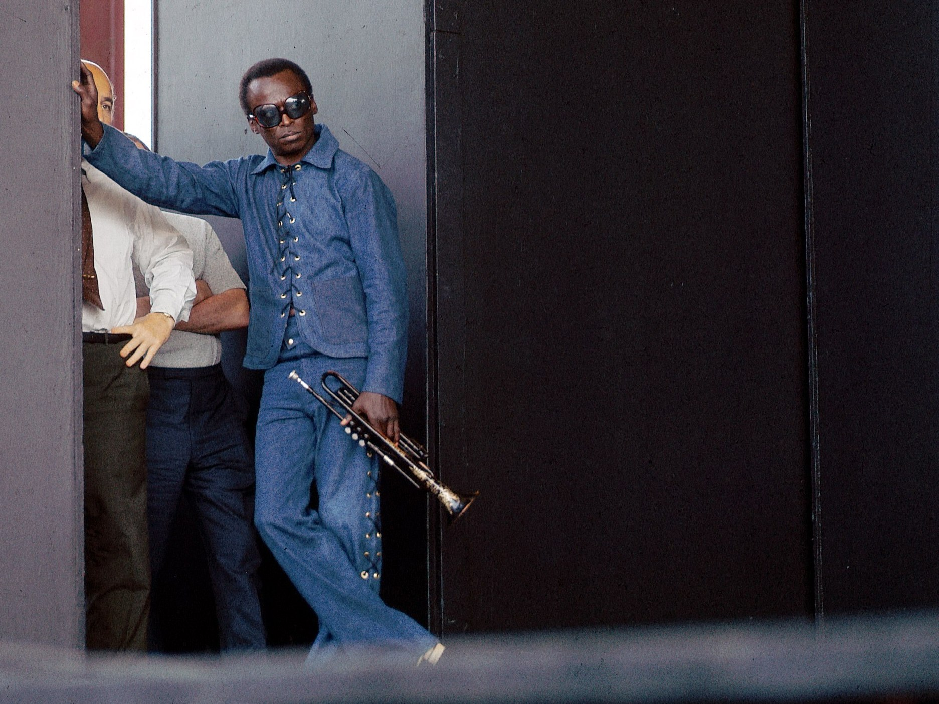 Miles Davis poses at the side of stage during the Newport Jazz Festival.